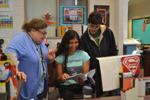 From left: Media Specialist Sherry Weiss talks to student aides senior Lisa Da��Souza and junior Avery Eng. IMC hours will be cut due to budget shortages. --Camila Torres