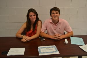 Seniors Mark Pankowski and Joanna Klinedinst pose for a photo as they run the NHS tutoring table.