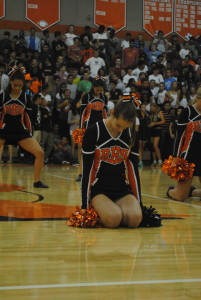 Senior Poms captain, Samantha Dellenoci prepares to perform during the pep rally.