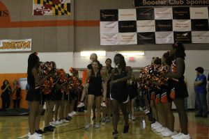 Lady Rams varsity tennis team enter the gym at the start of the pep rally.