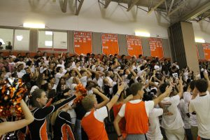 "Senior students chant ""freshman"" and ""we can't hear you"" during the pep rally."
