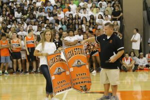 Junior Alexa Stewart accepts banners for swimming.
