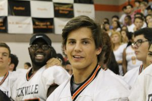 Senior Erik Blautzik smiles for the camera during the pep rally.