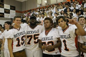 (Left to right) Senior football players, Brandon Geddes, Manny Essien, Brandon Taylor and Erik Blautzik pose for a picture.