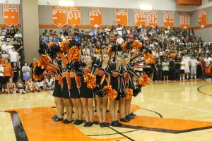 The poms team performs.