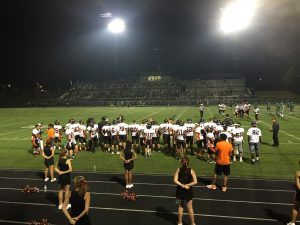 """Orange and Black bleed in the Walter Johnson stadium. """"I am so proud to go to Rockville. We have such a great community and spirited group of kids,"""" senior Anna Weiler said."""