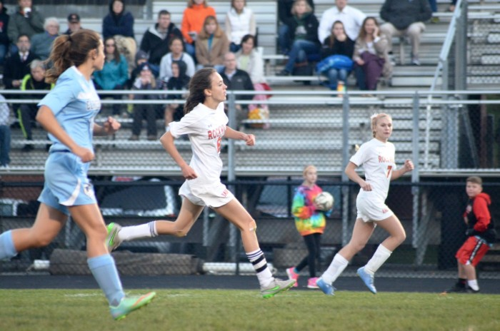 Senior Anna Weiler chases after the ball.