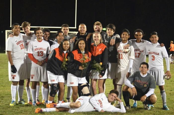 Seniors from the girls and boys varsity teams pose together for a picture.