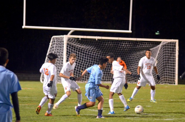 Players from Rockville and Clarksburg struggle to take control of the ball.