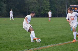 Lima dribbles the ball away from the sideline.