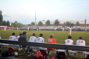 Rockville players watch the game intently from the sideline.