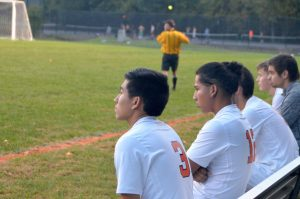 Senior Steve Cevallos and teammates watch the game progress.