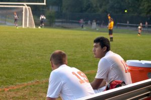 Junior Thomas Da Silva and Senior Diego Mendoza worriedly watch the game.