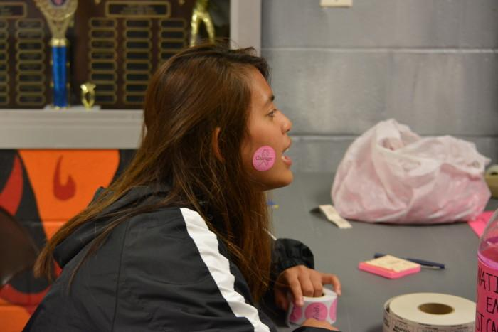 Senior Grace Cajayon asks for donations. All donations from the game go towards breast cancer research.