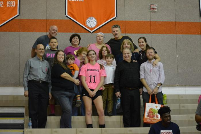 Jones poses with her family after the game. Her mother was diagnosed with breast cancer in May, 2015.