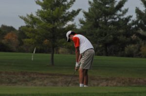 Freshman Cole Kirchner attempts to lob the ball onto the greens.