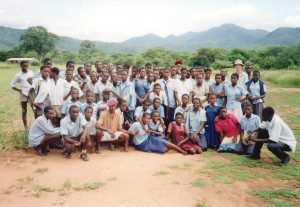 Mark Bradley poses with high school students while serving in Zimbabwe. Photo Courtesy of Mark Bradley