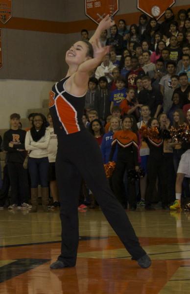 Mia Krawczel performs a baton routine.